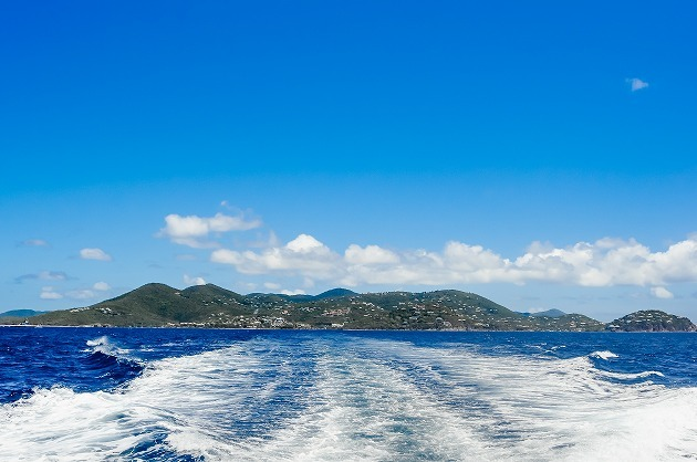 Island And Waves From The Back Of A Boat.jpg